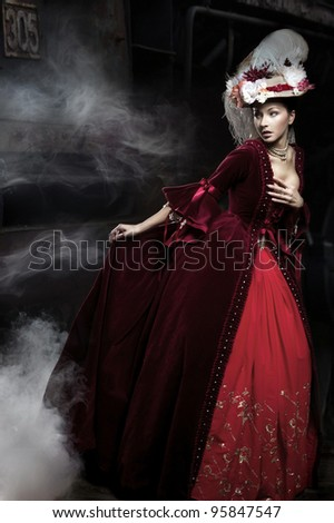Beautiful woman wearing red dress over a train - stock photo