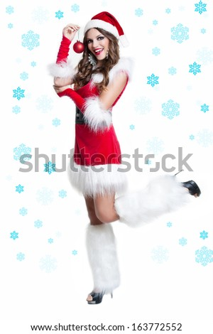 Beautiful woman wearing santa clause costume background of the snow-flakes . Christmas