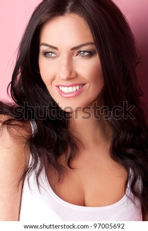 Beautiful woman with a beautiful big smile and a sparkle in her eyes. - stock photo
