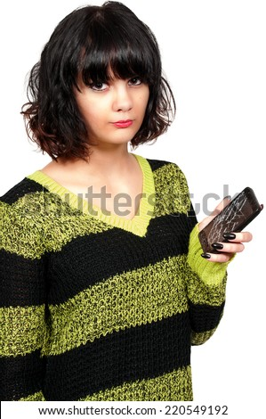 Beautiful woman with a broken cracked phone screen - stock photo