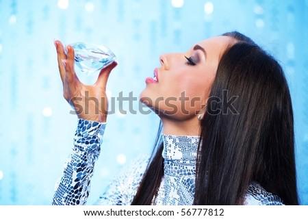 Beautiful woman with a diamond - stock photo