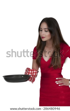 Beautiful woman with a frying pan who doesnt want to cook - stock photo