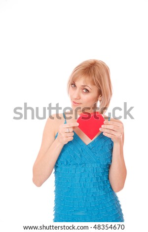 Beautiful woman with a heart gift in her hands over white background