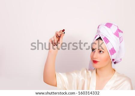 beautiful woman with a lipstick - stock photo