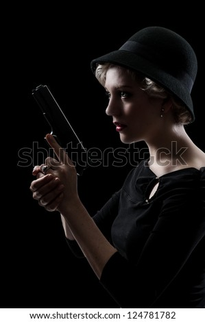 Beautiful woman with a loaded handgun pistol