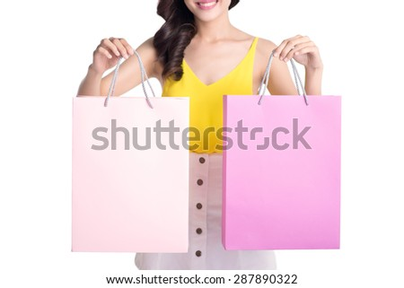 Beautiful woman with a lot of shopping bags. Female hands holding a shopping bags - stock photo