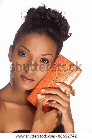 beautiful woman with a lovely orange purse - stock photo