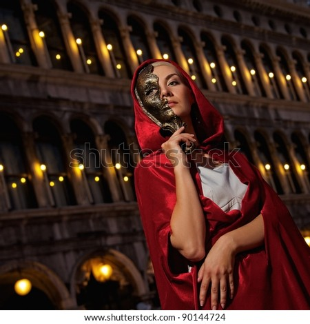 Beautiful woman with a mask outdoor - stock photo