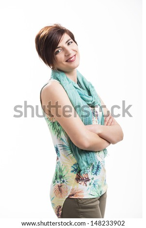 Beautiful woman with a modern hair cut, standing over a white background - stock photo