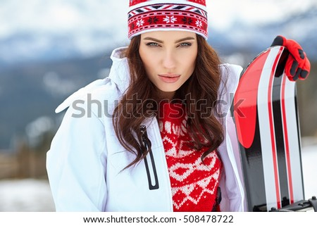 beautiful woman with a snowboard.