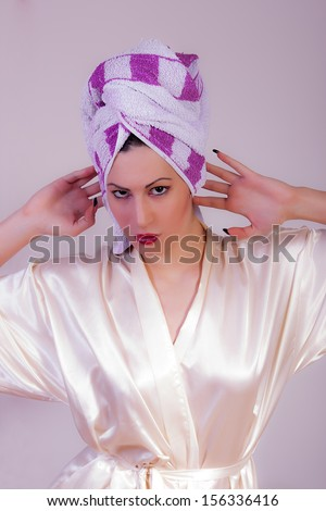 beautiful woman with a towel on her head on a white background - stock photo