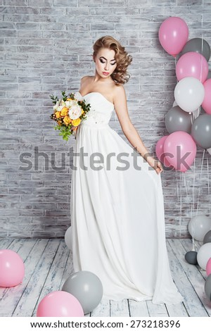 Beautiful woman with a wedding bouquet - stock photo