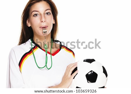 beautiful woman with a whistle wearing football shirt holding football on white background - stock photo