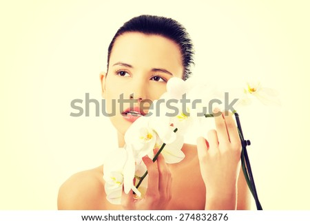 Beautiful woman with an orchid