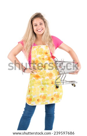 Beautiful woman with apron and shopping cart