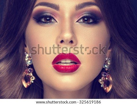 Beautiful woman with arabic make-up, red lips and curls. Beauty face. Insta Color - stock photo
