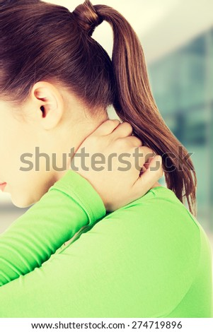 Beautiful woman with back pain - stock photo