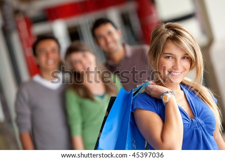 Beautiful woman with bags at a shopping center