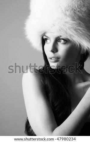 Beautiful woman with big white fur hat. - stock photo