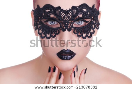 Beautiful Woman with Black Lace mask over her Eyes.  Black Manicure and Lipstick. Manicure and Makeup. Make up concept. Passion  - stock photo