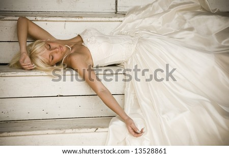 beautiful woman with blond hair wearing luxurious wedding dress - stock photo