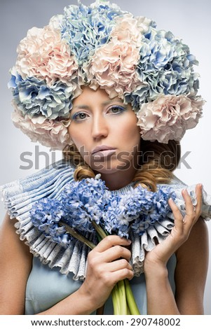 Beautiful woman with blue flowers - stock photo