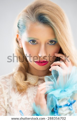 Beautiful woman with blue lace - stock photo
