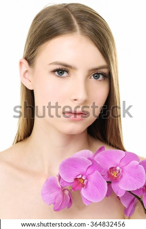 Beautiful woman with branch pink orchid  - stock photo
