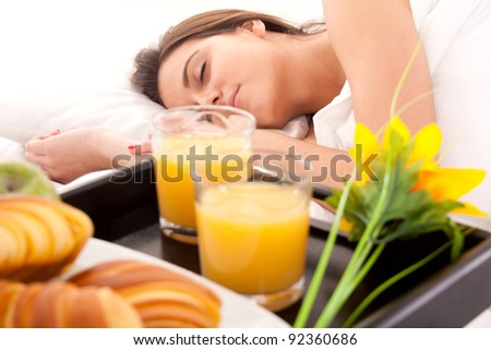 Beautiful woman with breakfast in bed
