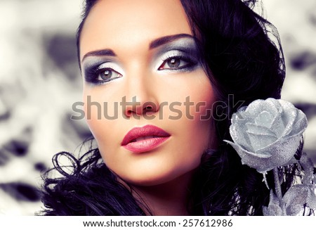 Beautiful woman with bright fashion make-up - stock photo