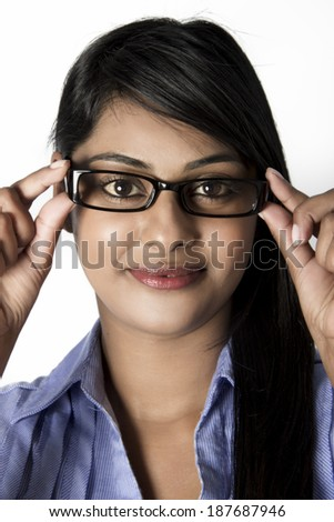 Beautiful woman with brown eyes , framed glasses on her face