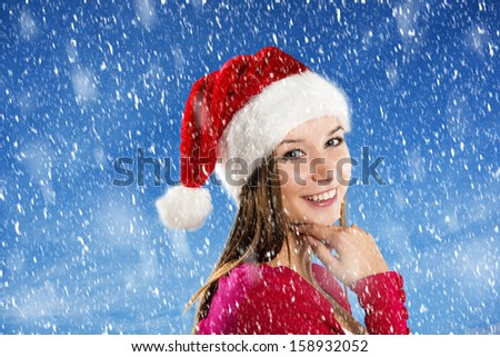 Beautiful woman with christmas hat in winter nature