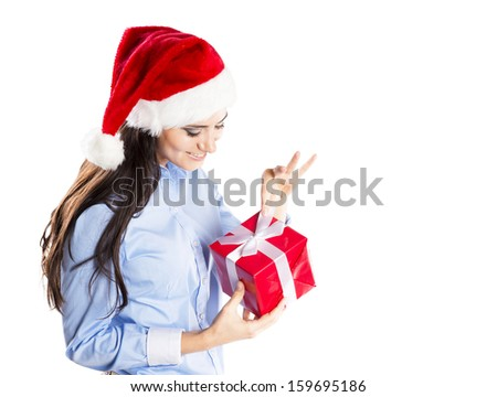 Beautiful woman with christmas hat is holding gift. Isolated on white background. - stock photo