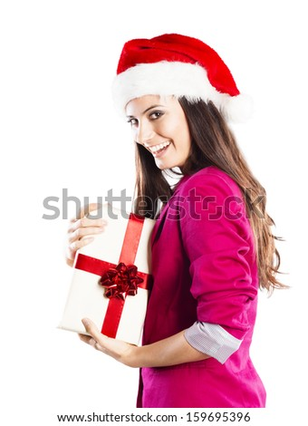 Beautiful woman with christmas hat is holding gift. Isolated on white background.