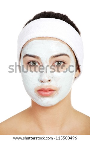 Beautiful woman with clay facial mask, isolated on white - stock photo