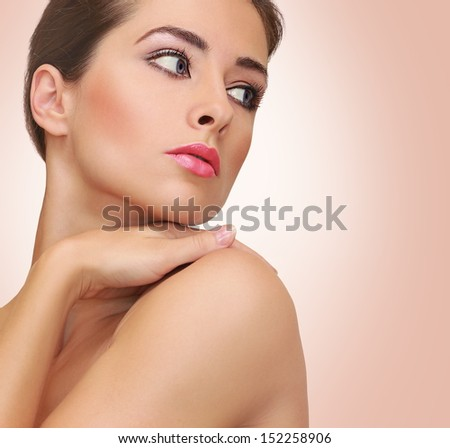 Beautiful woman with clean skin on pink background. Soft closeup portrait - stock photo