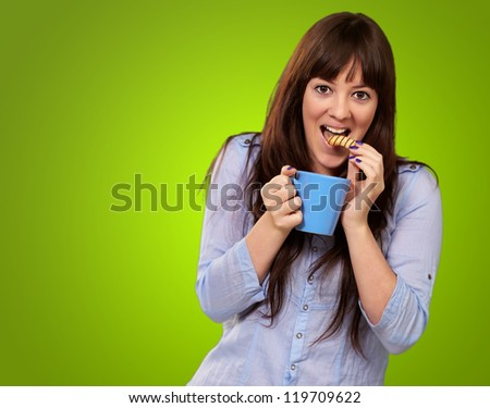 Beautiful Woman With Coffee And Cookies Isolated On Green Background - stock photo