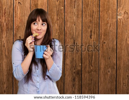 Beautiful Woman With Coffee And Cookies On Wood - stock photo
