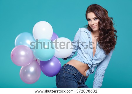 Beautiful woman with colored balloons - stock photo