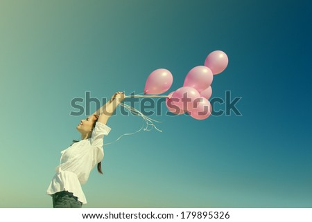 beautiful woman with colorful balloons outside - stock photo