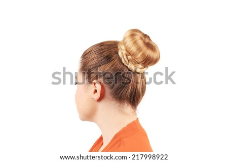 Beautiful woman with creative elegant hair bun. Isolated on a white background.  - stock photo