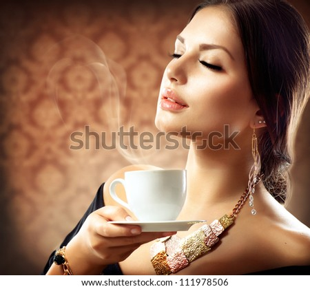 Beautiful Woman With Cup of Coffee or Tea - stock photo