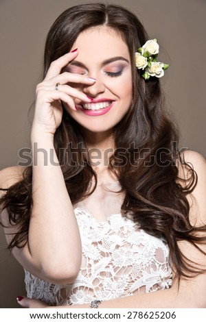 Beautiful woman with curly hair and roses. Beautiful bride. - stock photo