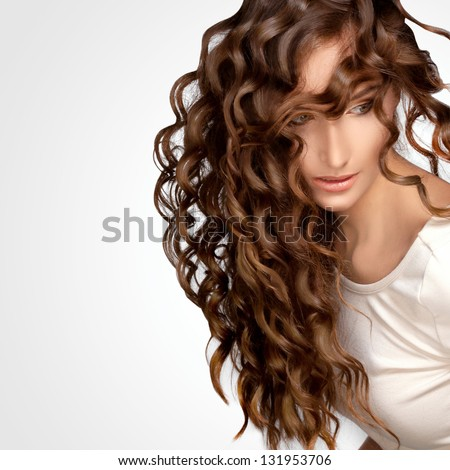 Beautiful Woman with Curly Long Hair. High quality image.