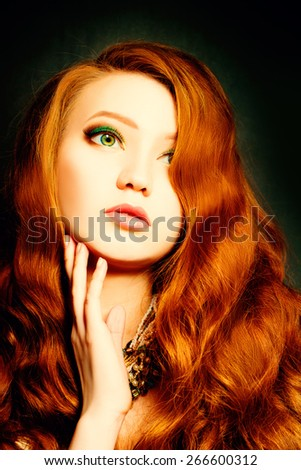 Beautiful woman with curly red hair. Makeup and Hairstyle - stock photo