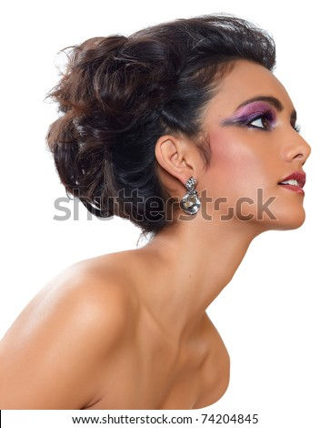 beautiful woman with dark tanned skin and long black hair in fashion hairstyle and earrings. - stock photo