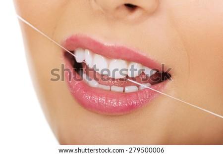 Beautiful woman with dental floss. - stock photo