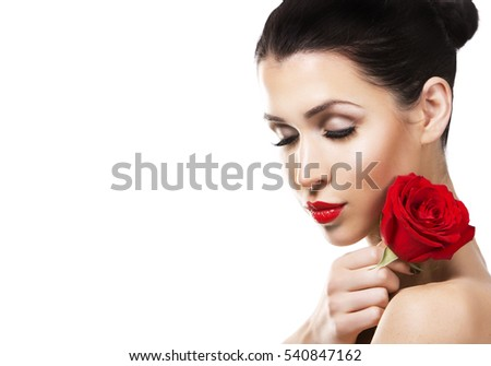beautiful woman with dramatic makeup and red lips. Red flower rose.