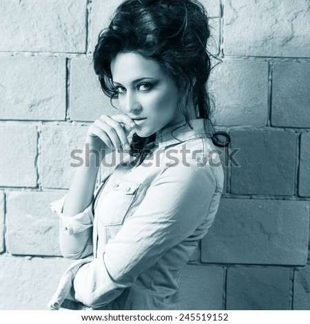 Beautiful woman with elegant hairstyle. Fashion photo - stock photo
