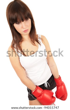 Beautiful woman with emotions in boxing gloves